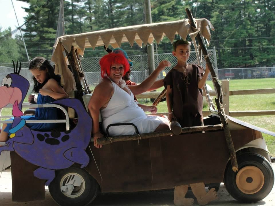 Hanmade flintstone costumes and decorated golf cart
