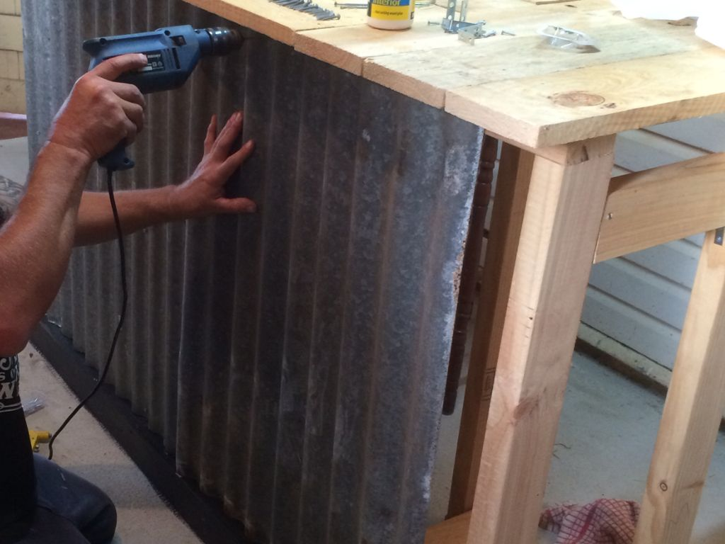 Attaching The Corrugated Iron Sheets To Front Of Bar We Bought