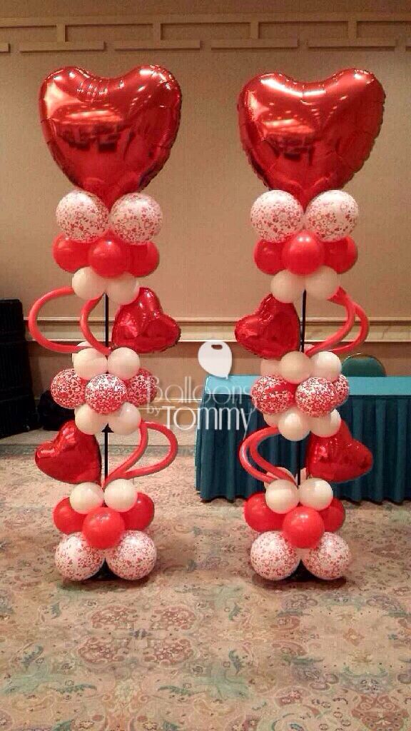 This red and white heart filled balloon column can be used for Balloon decoration for valentines day