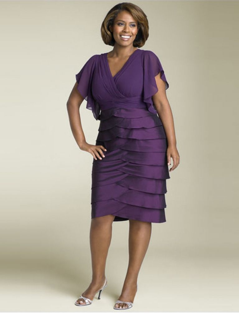This dress is a lovely cut for a full-figured woman. The deep purple ...