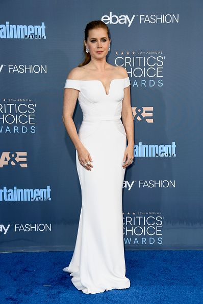 Actress Amy Adams in Versace, Jimmy Choo shoes, and Nirav Modi jewelry attends The 22nd Annual Critics' Choice Awards at Barker Hangar on December 11 2016 in Santa Monica California