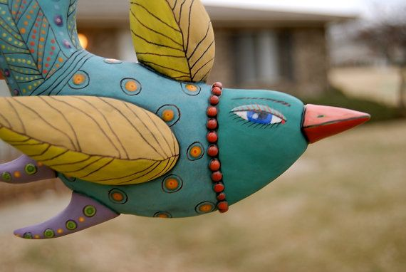 Turquoise Bird with Yellow Wings $75
