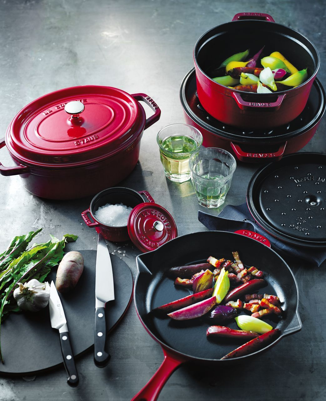 Staub's industrial-chic enameled cast iron cookware comes in red ...