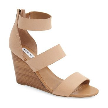 90afe84abce karey wedge sandal by Steve Madden. A trio of smooth leather straps tops  the foot on a minimalist sandal lifted by a stacked woodgrai.