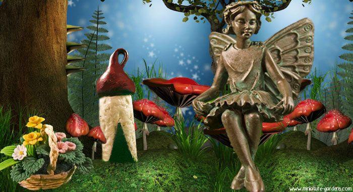 Evelyn Mae fairy in the fairy garden.