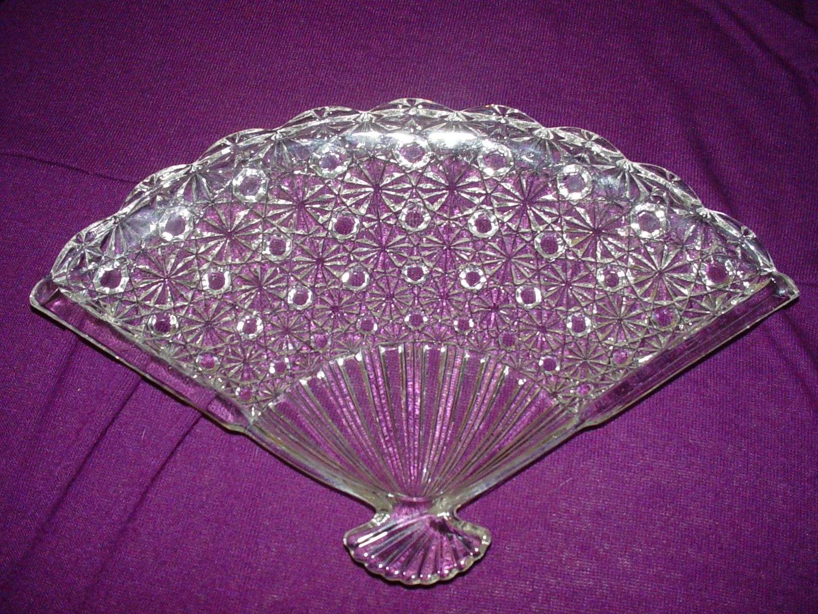 Fan shaped dresser tray. Not absolutely sure who the maker is.