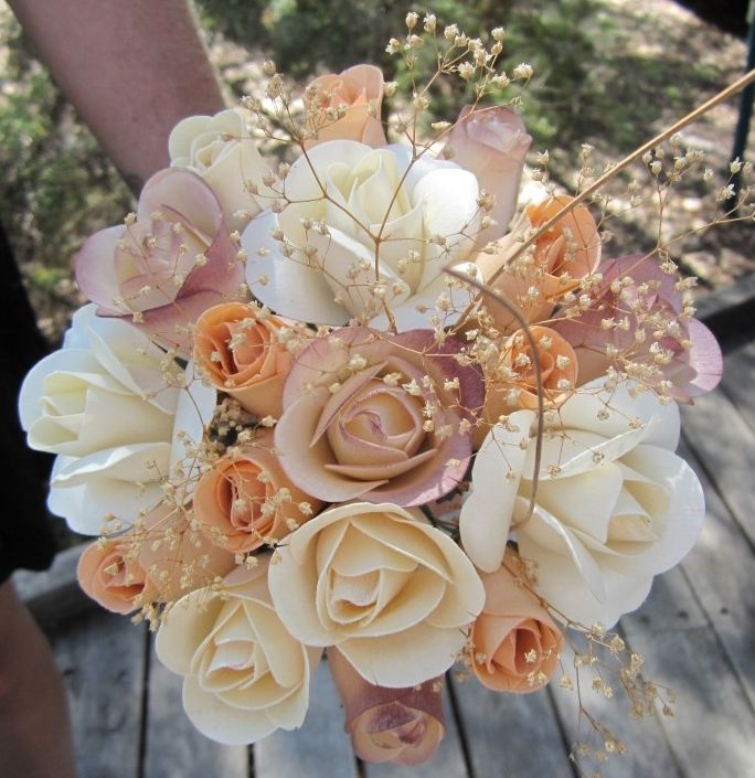 A bouquet of wooden roses was carried by Emma when she married David at Seary's Creek near beautiful Rainbow Beach. How unique and how beautiful.