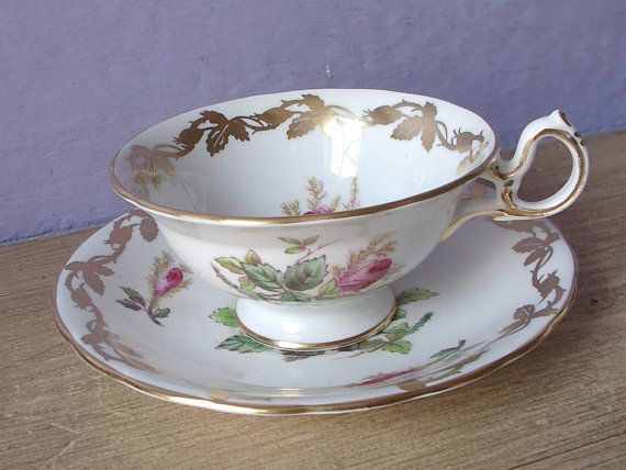 Antique Hand Painted roses tea cup and saucer by ShoponSherman