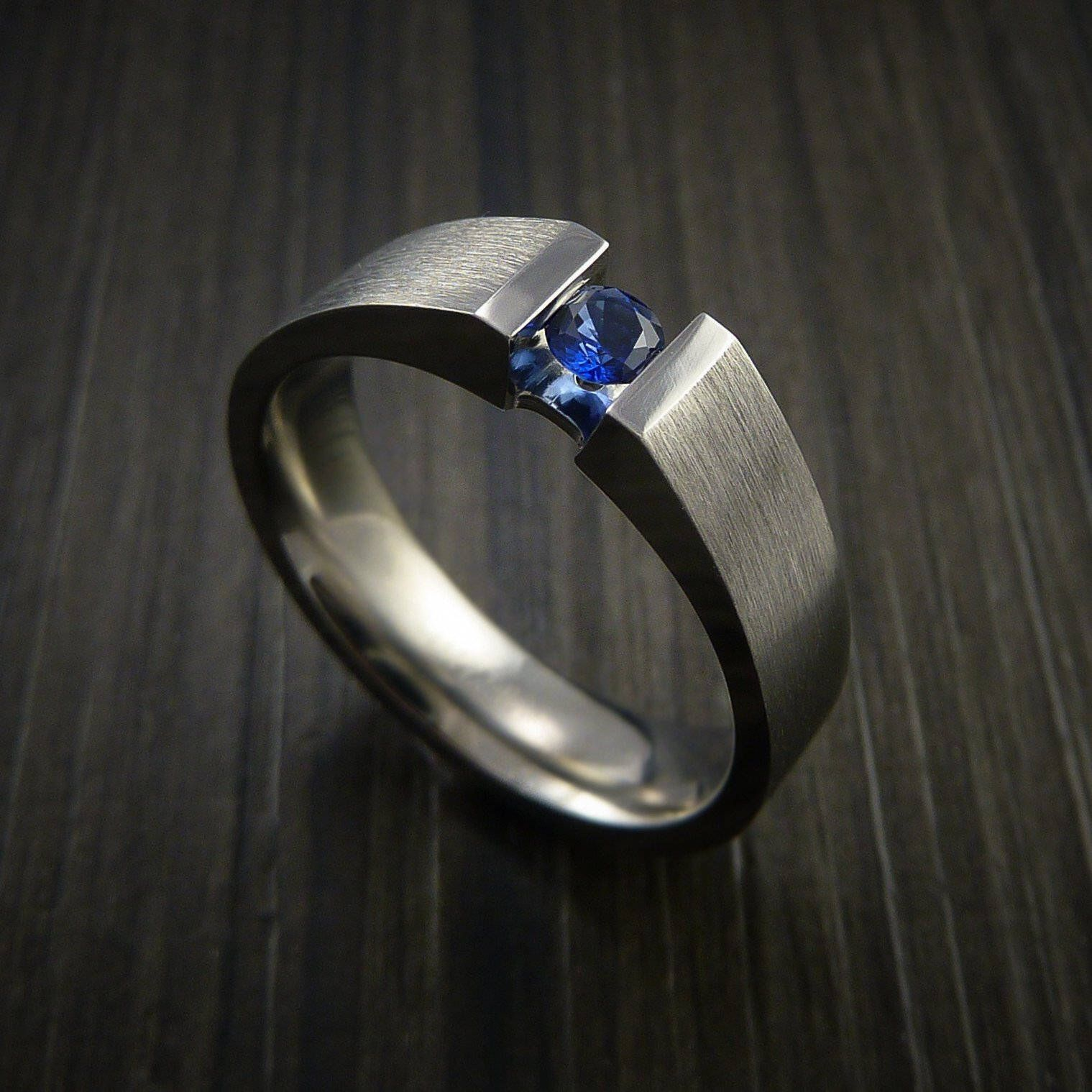 Titanium ring tension set band with round blue sapphire
