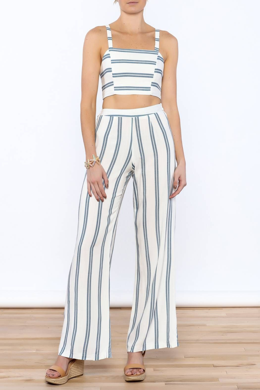 727d3e5b11 Sleeveless fitted crop top with thick straps and a lace-up back closure.  High waist wide-leg pants with a hidden side zipper. Stripe Pant Set by  luxxel.