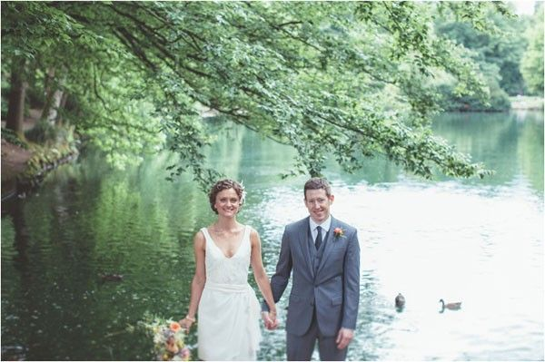 The newlyweds standing in front of Willamette River in Portland, Oregon | Hazelwood Photo | See more of this chic Portland #wedding here: http://www.mywedding.com/articles/eric-and-natalies-chic-portland-or-wedding-by-hazelwood-photo/
