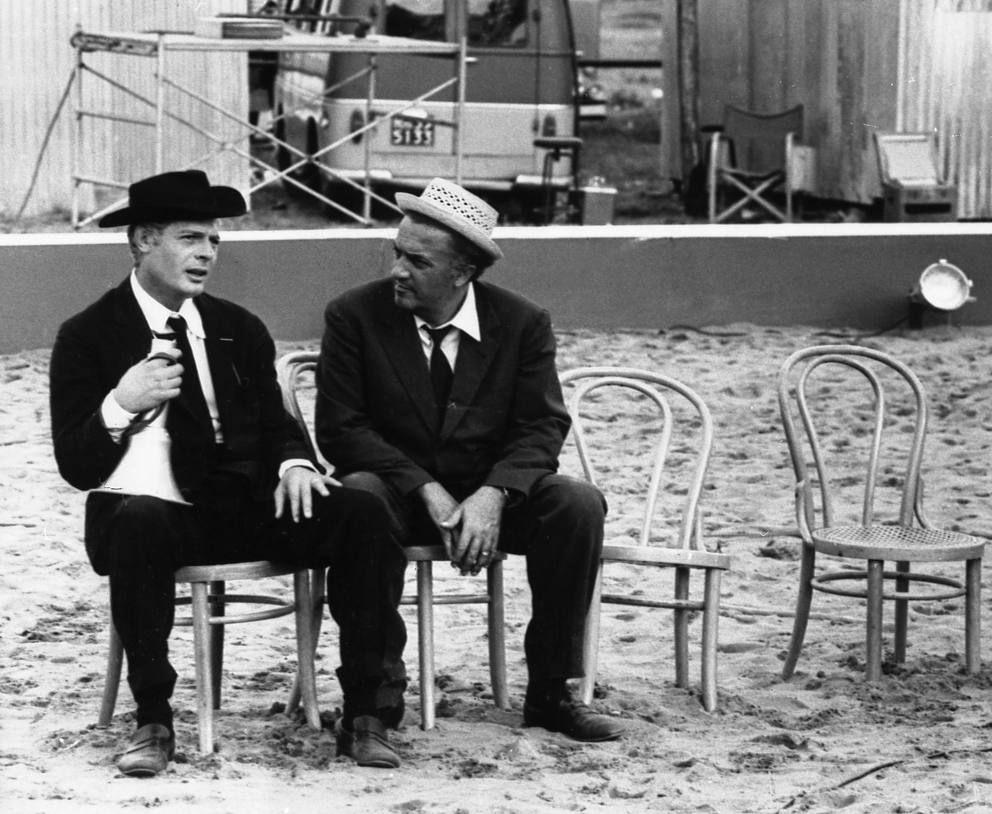 "Marcello Mastroianni and Federico Fellini on the set of ""8 1/2″"