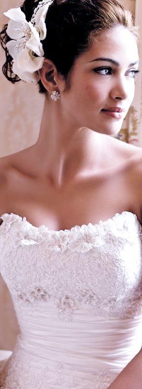 Bride's sleek updo bridal hair Toni Kami Wedding Hairstyles ♥ ❷ Wedding hairstyle ideas Beautiful bodice wedding gown dress