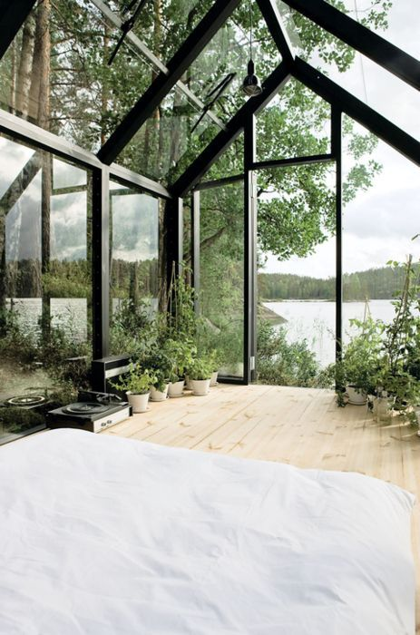Beautiful bedroom with a view. http://www.countryliving.com/gardening/a35611/modular-glass-cabin-she-shed/?utm_content=buffer36fc0&utm_medium=social&utm_source=pinterest.com&utm_campaign=buffer #modernzinc #freshsheets