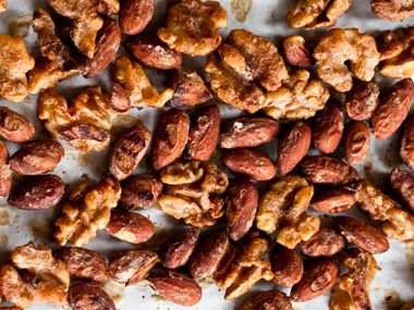 Preheat the oven to 325 degrees Fahrenheit. Mix 1 1/2 teaspoons ground cinnamon, 1 teaspoon ground ginger, 1 1/2 teaspoons vanilla extract, and 1 1/2 teaspoons extra-virgin olive in a large bowl. Add 4 ounces shelled raw walnut halves, 4 ounces shelled raw pecan halves, and 4 ounces raw cashews. Massage in the spices well, then place on baking sheet and bake for 10-12 minutes.