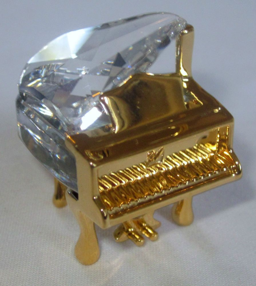 Miniature crystal model of a Piano by Swarovski.  I have this