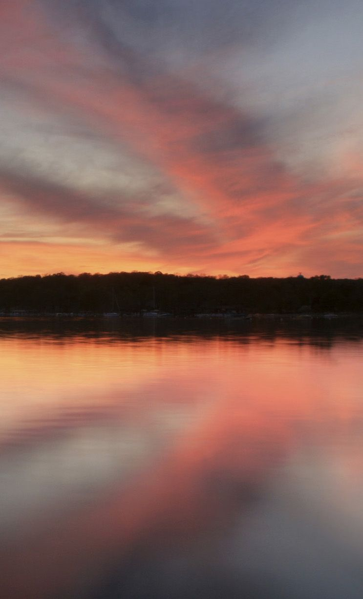 A Pretty Sunset Over Lake Geneva In Wisconsin. Search Groupon For  Discounted Lodging In Local