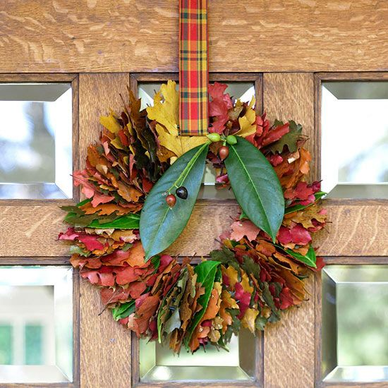 Easy Fall Leaf Wreath- Create an inviting look for your front door with an array of bright leaves strung together in this colorful wreath. To make, cut a slit in the center of leaves with small scissors or a utility knife (fresh leaves or pliable faux leaves from a crafts store work best). String leaves onto a wire wreath form until full; hang from a pretty plaid ribbon.