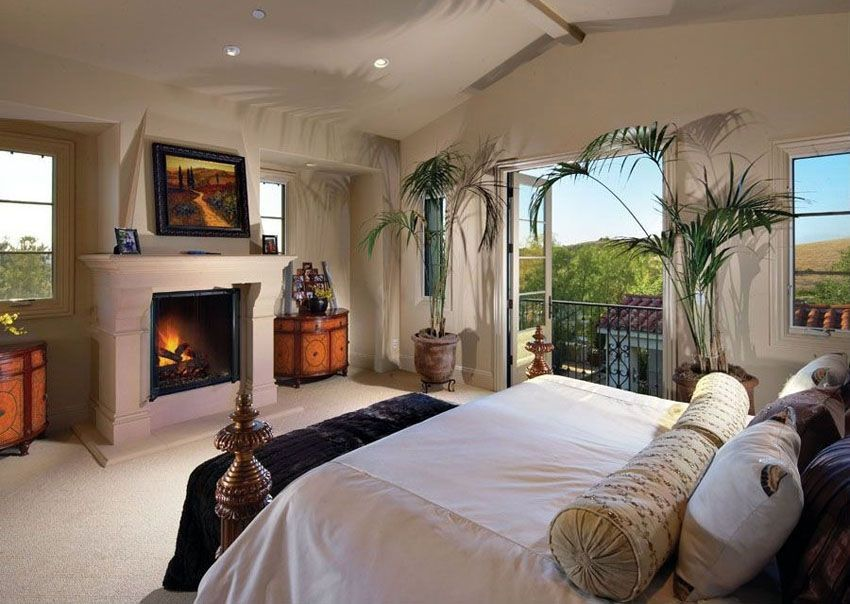 Traditional Luxury Master Bedroom With Fireplace Facing Bed