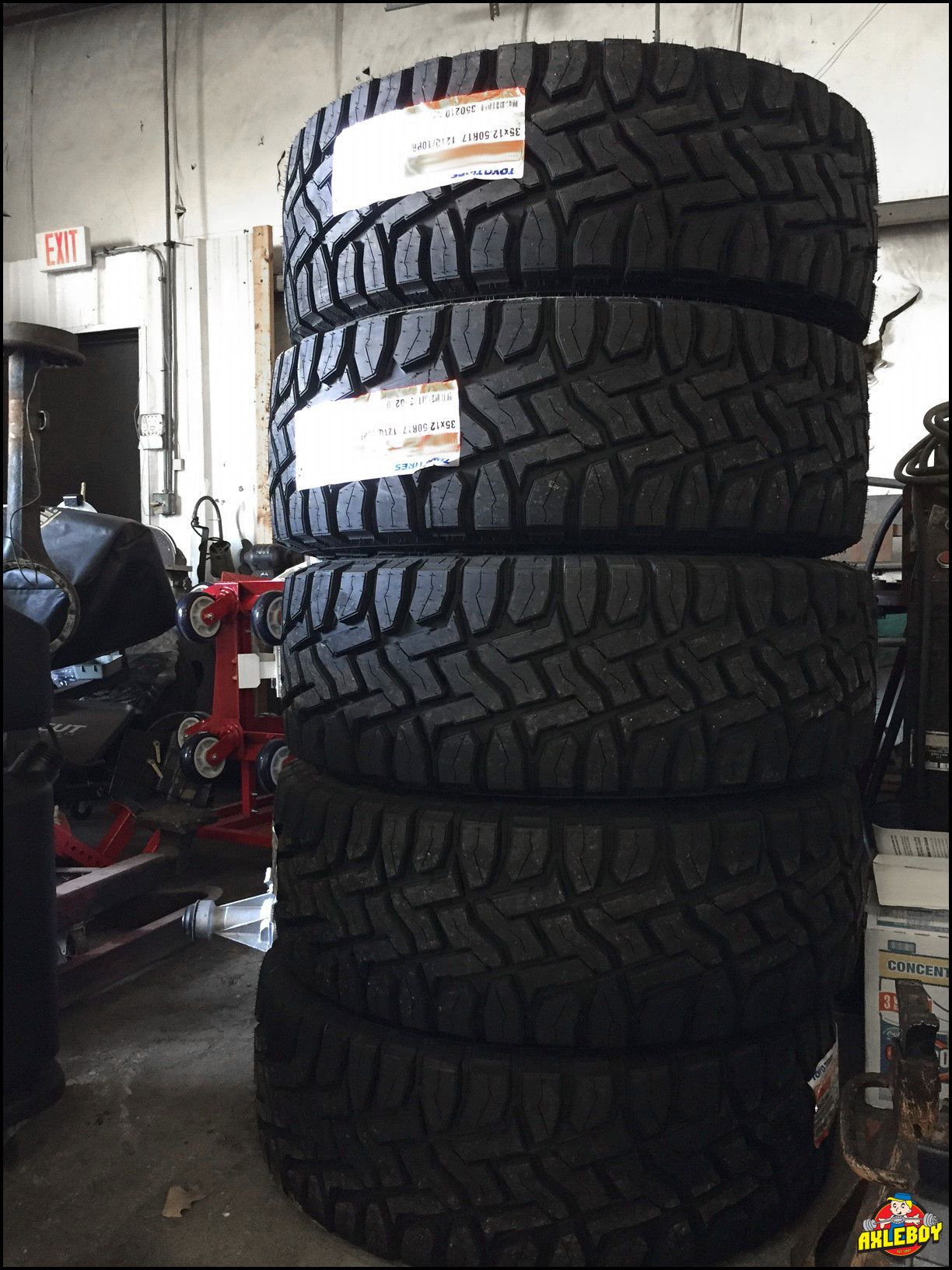 35x12 50 17 Toyo Open Country tires stacked 5 deep Axleboy jeep