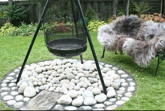 """A simple and nice area for a """"campfire"""" in the garden. Make a square or a circle in the ground, cover it with a pice of """"soilcover-cloth"""" and put some nice rocks or outdoor-tiles on top. Put a hammock, chairs or one or two garden- benches around the """"campfire-area"""". There you have a nice and cosy outdoor-space for recreation."""
