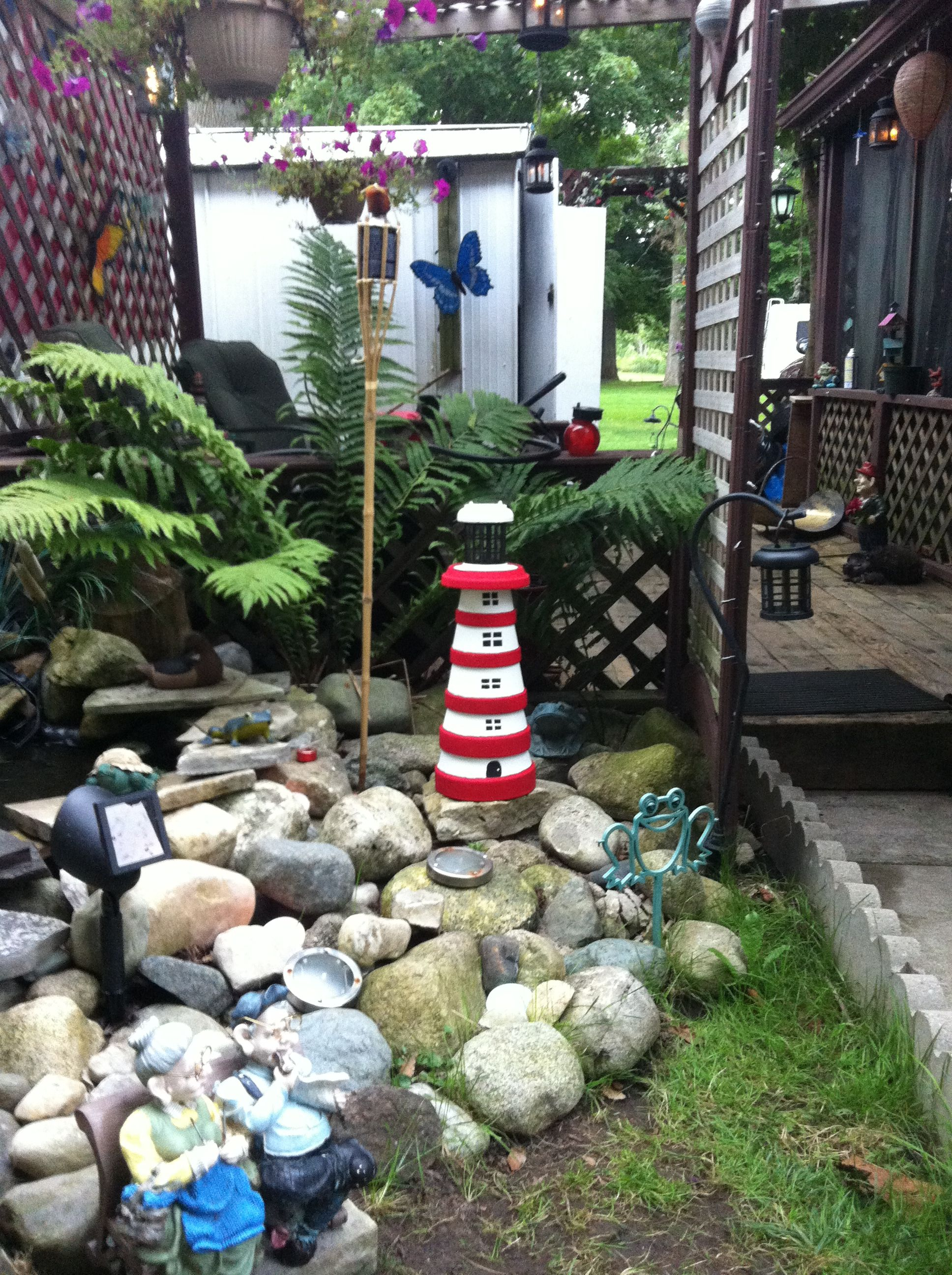 Clay pot lighthouse at our trailer pond