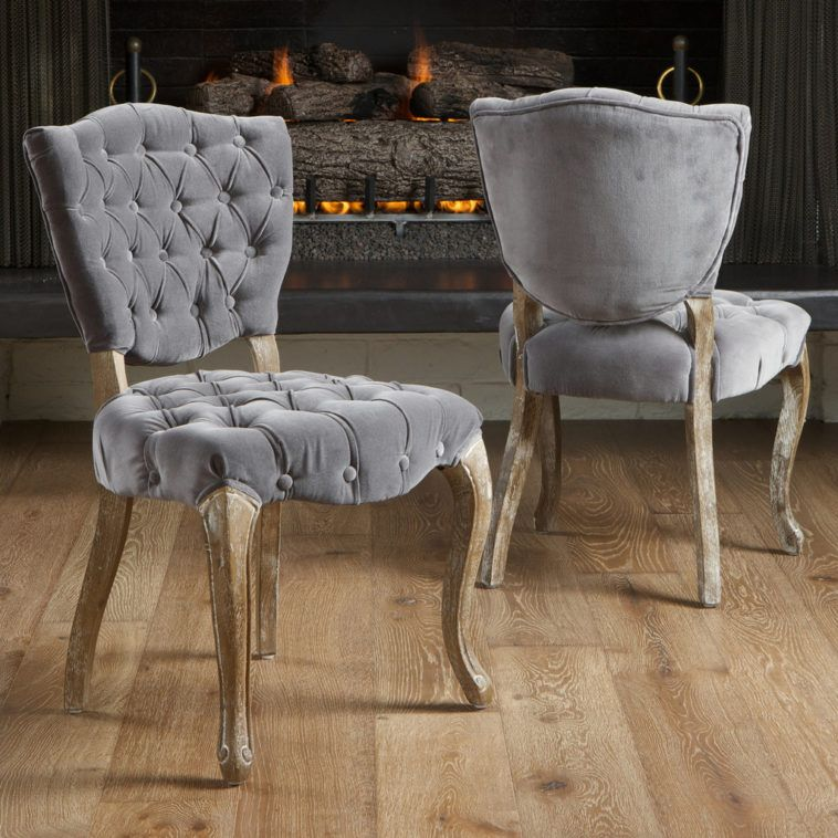 Gray Tufted Dining Chairs With Curved Legs On Nature Wood Floor