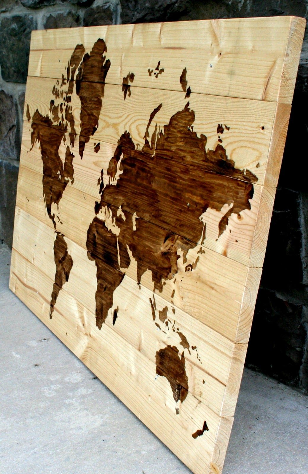 DIY Wooden World Map Art. Love this and love the idea of pictures/words with wood stain!