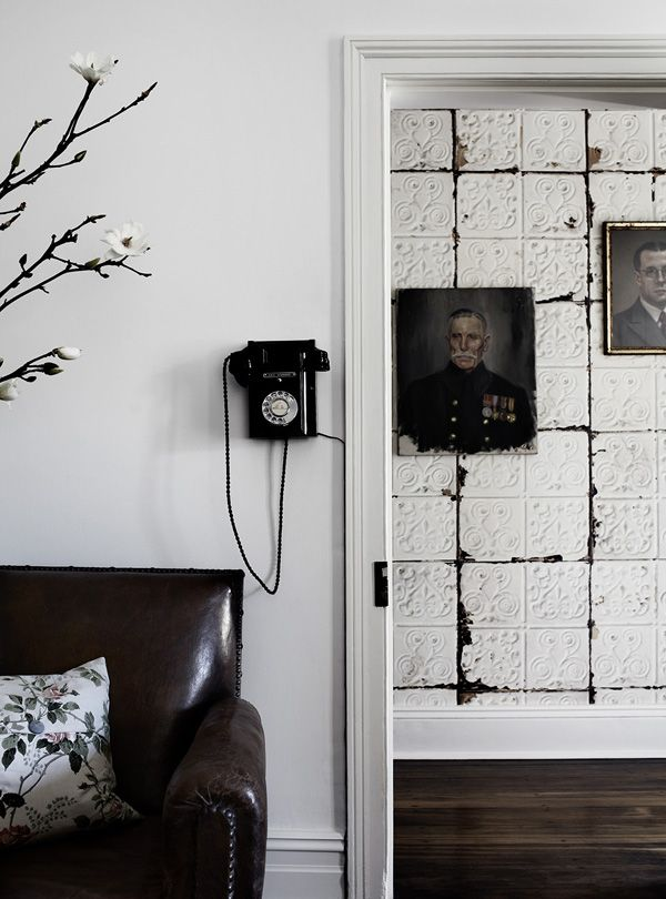 Great wallpaper that looks like an old metal pressed tile adds to the vibe of this