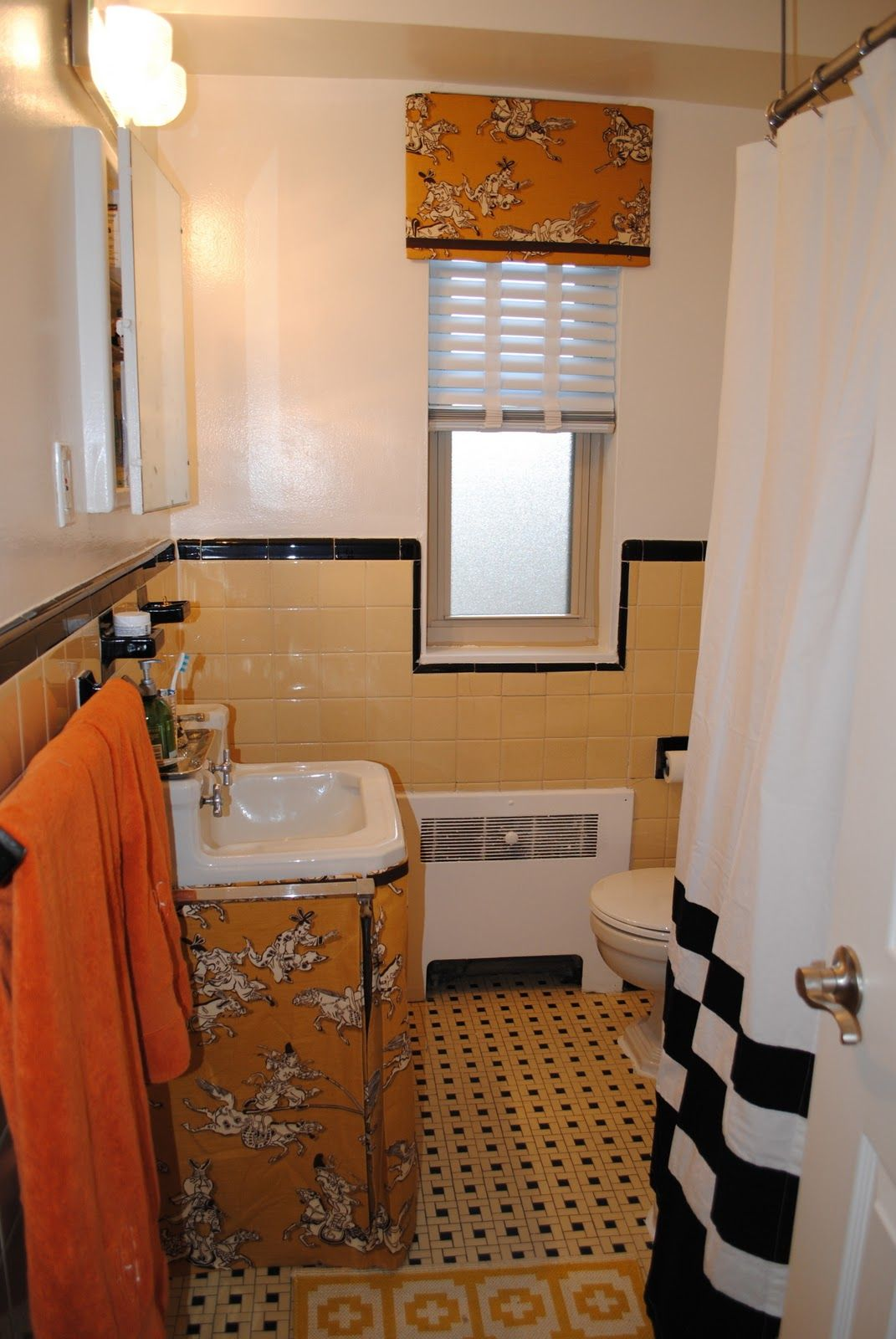Skirt On A Sink In A Pretty Yellow And Black Tiled Bathroom