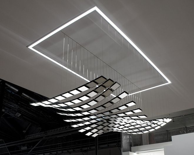 Selux manta rhei moving kinetic oled lighting its motion is lighting solution kinetic lumire of dynamic oled light ceiling mounted above white lamp selux manta rhei the astonishing experience of light for interiors aloadofball Images