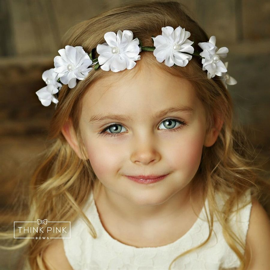 Magic moments flower crown 4 colors available things to buy this flower crown headband is made up of dainty flowers that are embellished with pearl centers and adorned with little green leaves izmirmasajfo