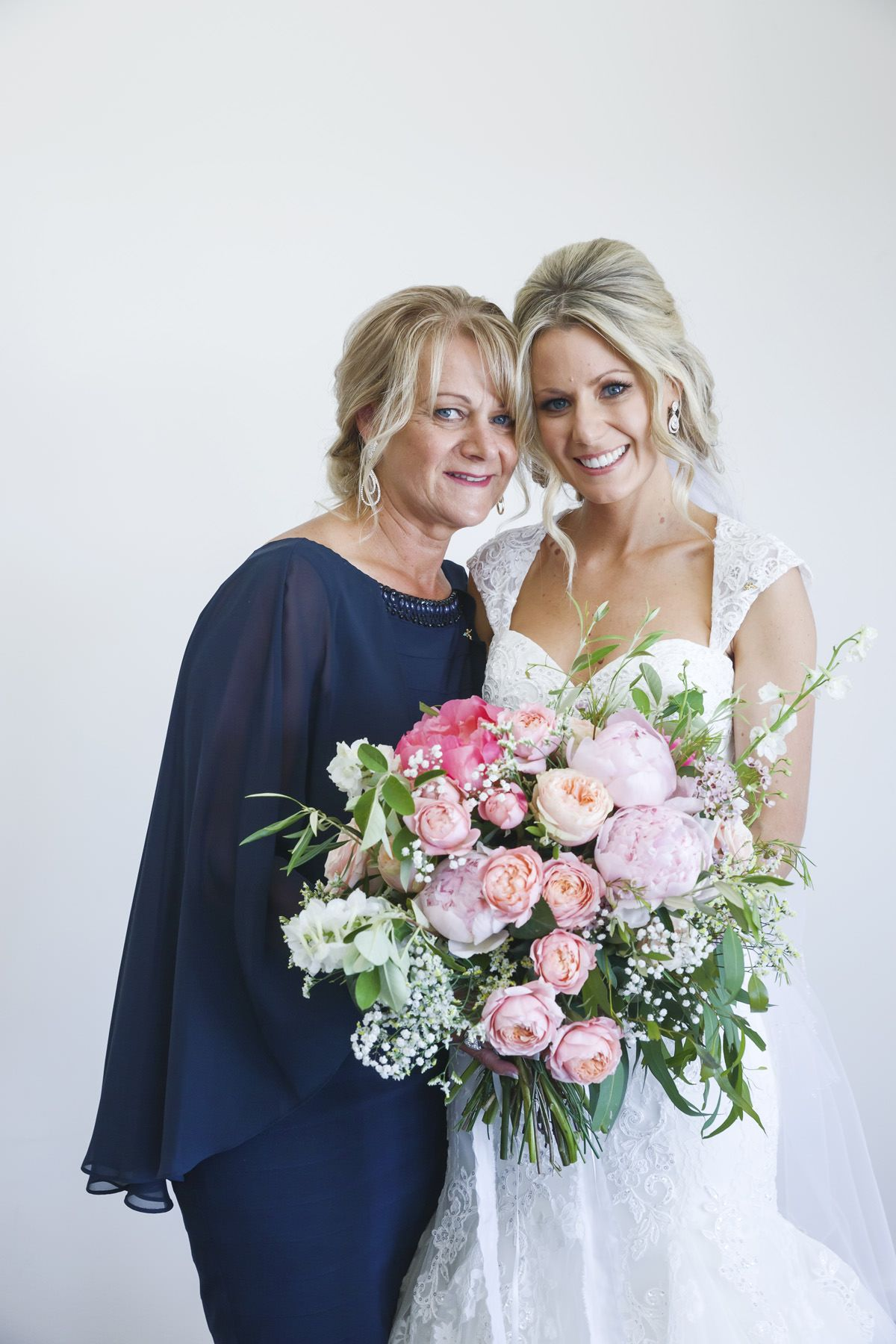 Mother of the bride in elegant navy gown Western