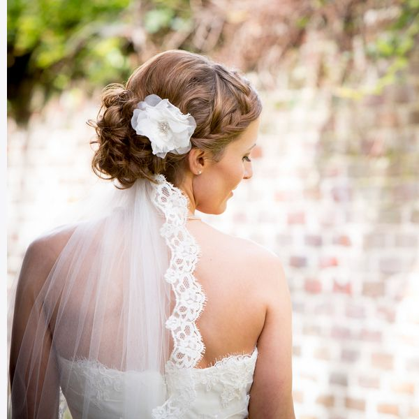 A braid can also serve as a beautiful addition to a more classic, pinned-up hairstyle. Ask your hairstylist to incorporate a smaller braid on whichever side you'll be facing guests during the ceremony.