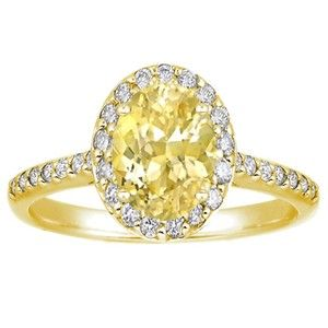 18K Yellow Gold Sapphire Fancy Halo Diamond Ring set with natural 8x6mm oval yellow sapphire.