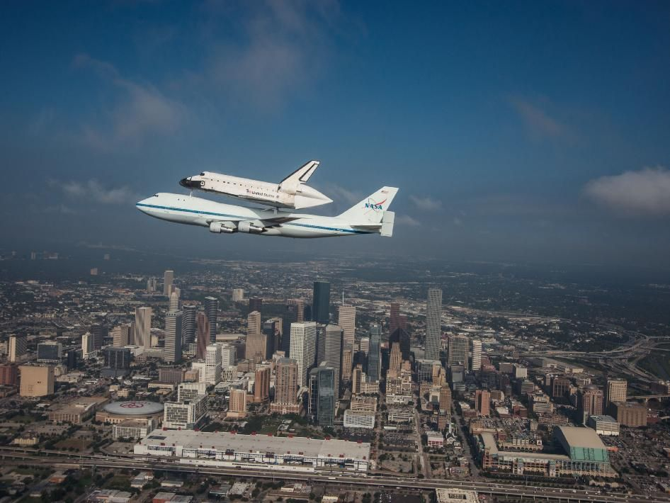 Space Shuttle Endeavour is ferried by NASA's Shuttle Carrier Aircraft (SCA) over Houston, Texas on September 19, 2012.