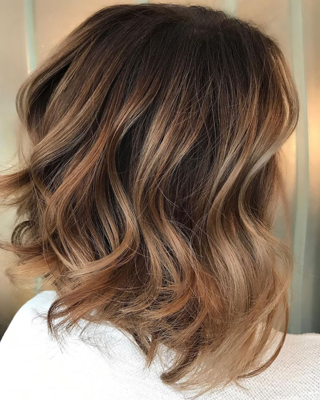 looks with caramel highlights on brown and dark brown hair in