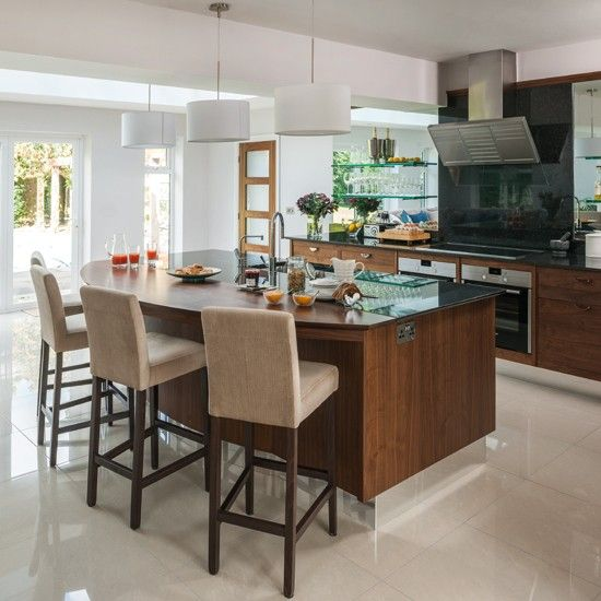 Modern glass and walnut kitchen with breakfast bar