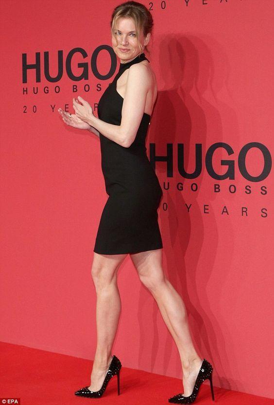 Renee Zellweger Sexy Legs In A Sleeveless Mini Dress And Sky High Heels