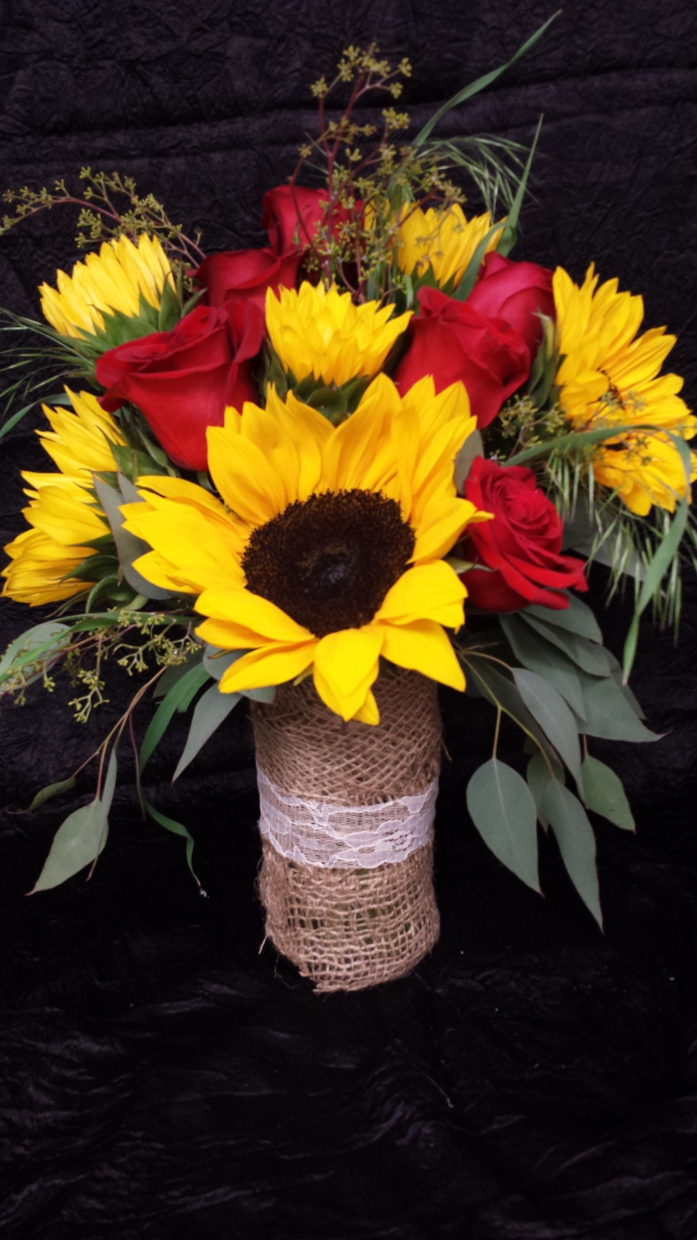 Sunflowers and red rose centerpiece with burlap lace