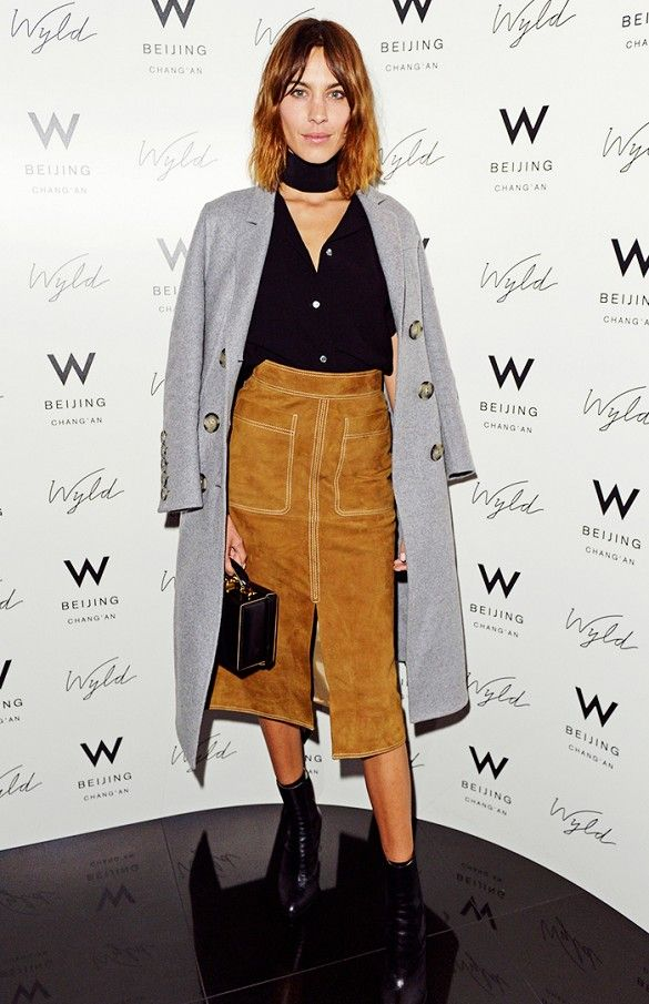 Alexa Chung in a camel suede skirt and grey duster coat