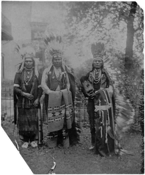 L-R: Peo-peo Ta'-lakt (AKA Bird Alighting) Chief Joseph, Hin-ma-toe Ya-lut-kiht (aka Thunder Rolling Over The Mountains, aka Joseph II) the son of Joseph I (AKA Tu-eka-kas, aka Shooting Arrow) – Nez Perce – and an unidentified man. Photo taken in Washington DC. - Nez Perce - 1900