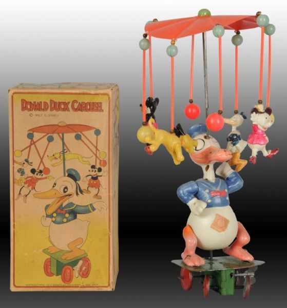 1fb4332f8ca Lot     1437 - Walt Disney Celluloid Donald Duck Carousel Toy ...