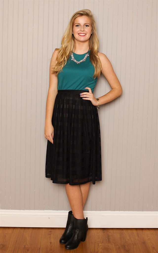 The Striped Black Midi Skirt - Black on black stripes come together to make the perfect skirt for work or night out in the city! Flowey, knee-length skirt in sheer over a solid slip material. Concealed zip at side. Model Advice: Fitted at the waistline.  Dress and Dwell - Good things for you and your home