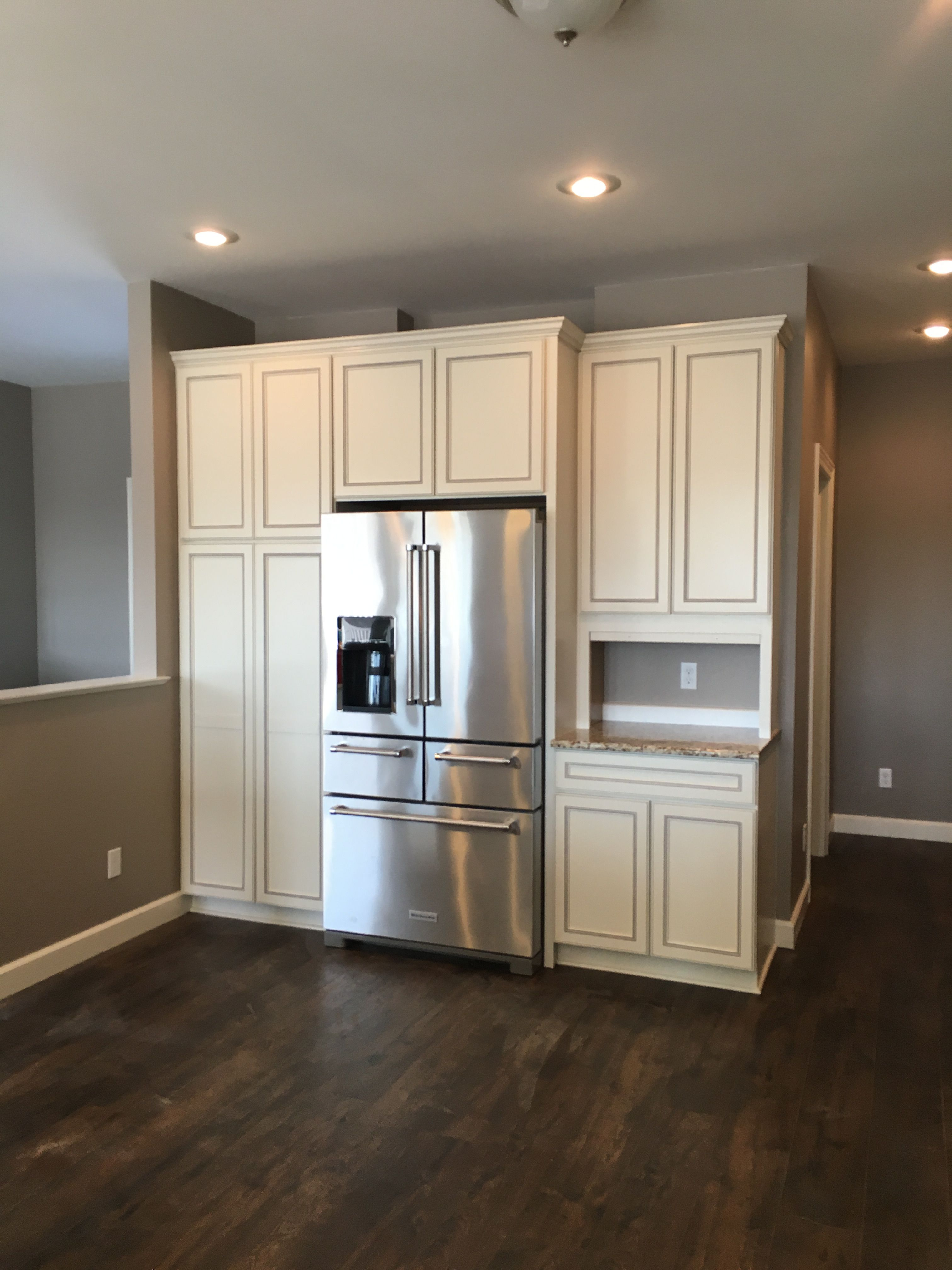 Beautiful Tall White Staggered Cabinets With Stainless Steel Refrigerator No Hardware On Cabinets Dar Tall Kitchen Cabinets Kitchen Remodel Kitchen Cabinets