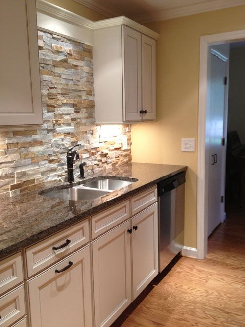 stone kitchen backsplash with white cabinets design