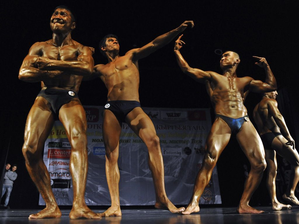 Competitors from Kyrgyzstan and Kazakhstan take part in the men's classic bodybuilding