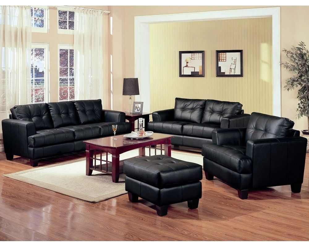 Luxurious cozy black leather sofa design in stunning peach colored wall living room design with glossy