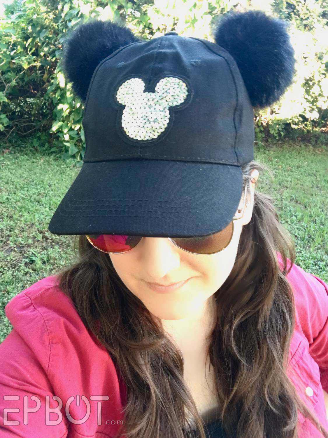 607009bce5a Ages ago I spotted a girl at the parks wearing a baseball cap with pom pom  Mickey ears