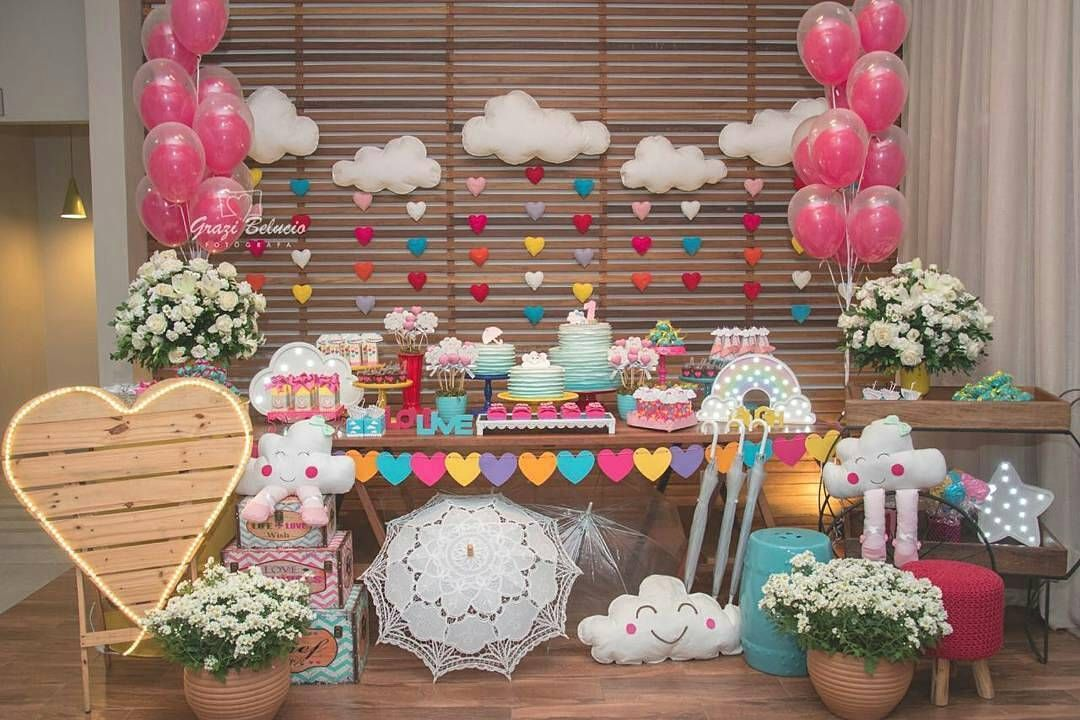 Not using a long table cloth allows the space under the table to be decorated with toys, umbrella, etc. I like this because it gives the eye a place to rest when there is alot of other fabric and things going around the room. Also, because you can put more decor into the area! Baby shower! cloud sewn pillows.